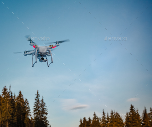 Modern Remote Control Air Drone Fly high in sky - Stock Photo - Images