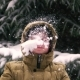 Boy Throws Snow Into His Face and Laughs - VideoHive Item for Sale