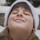 Snowflakes Fall on the Face of a Boy Who Smiles - VideoHive Item for Sale