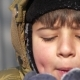 the Boy Squeezes His Eyes and Blows the Snow From His Palms - VideoHive Item for Sale
