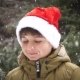 a Boy in a Red Christmas Hat Rejoices in Winter and Snow - VideoHive Item for Sale
