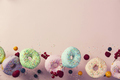 Sweet and colourful doughnuts falling or flying in motion - PhotoDune Item for Sale