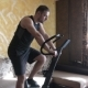 Man Training on Exercise Bike at Home - VideoHive Item for Sale