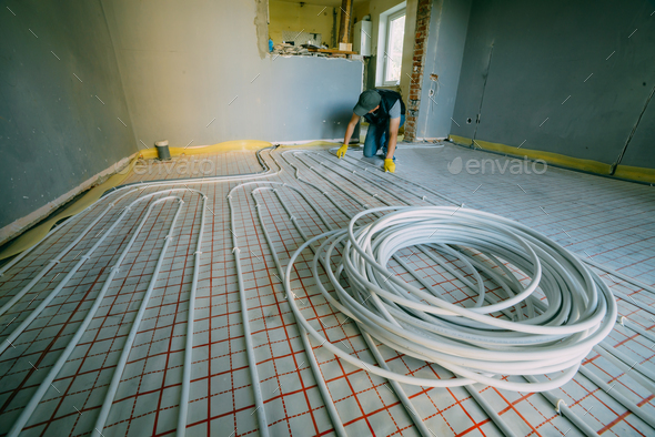 Pipefitter installing system of heating - Stock Photo - Images
