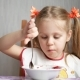 Little Girl Eats a Spoon with a White Bowl - VideoHive Item for Sale