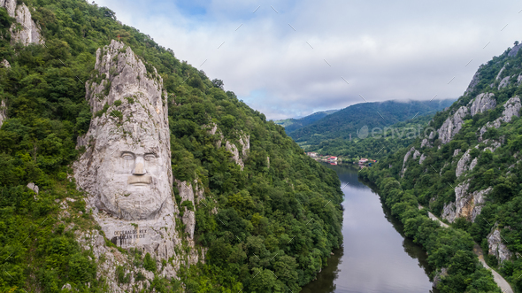 Decebal Head sculpted in rock - Stock Photo - Images