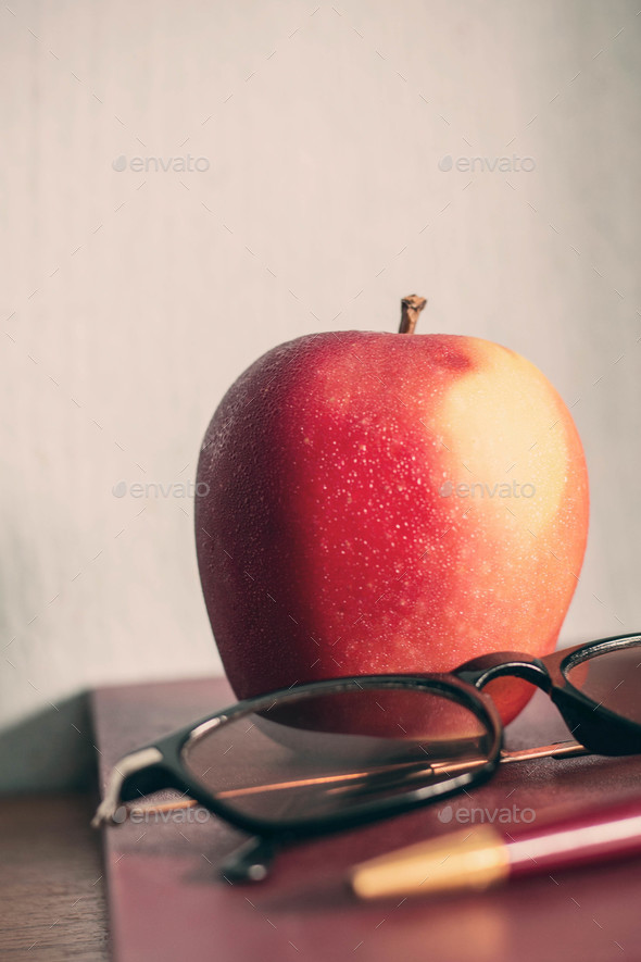 Apple on old book - Stock Photo - Images