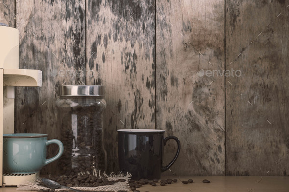 Cup and beans on wooden - Stock Photo - Images