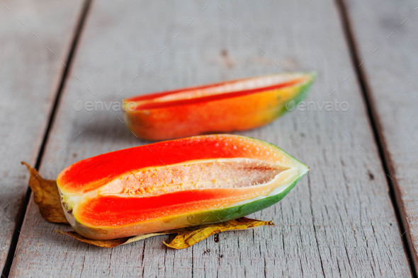 Papaya of half on wooden - Stock Photo - Images