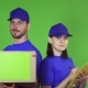 Cheerful Delivery Workers with a Package Smiling To the Camera - VideoHive Item for Sale