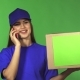 Gorgeous Female Delivery Service Worker Delivering Package Talking on the Phone - VideoHive Item for Sale