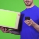 Deliveryman with a Package Texting His Client Using Smart Phone - VideoHive Item for Sale