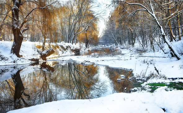 Winter landscape by a river - Stock Photo - Images