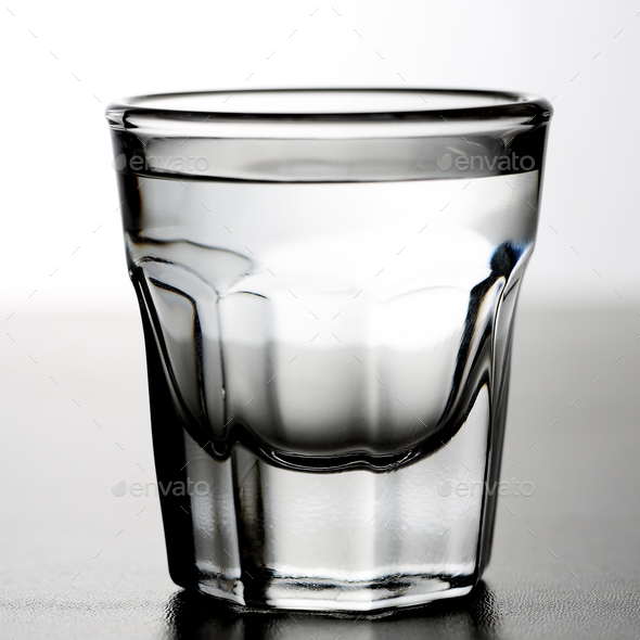 Shot glass of alcoholic drink as tequila or vodka or gin - Stock Photo - Images