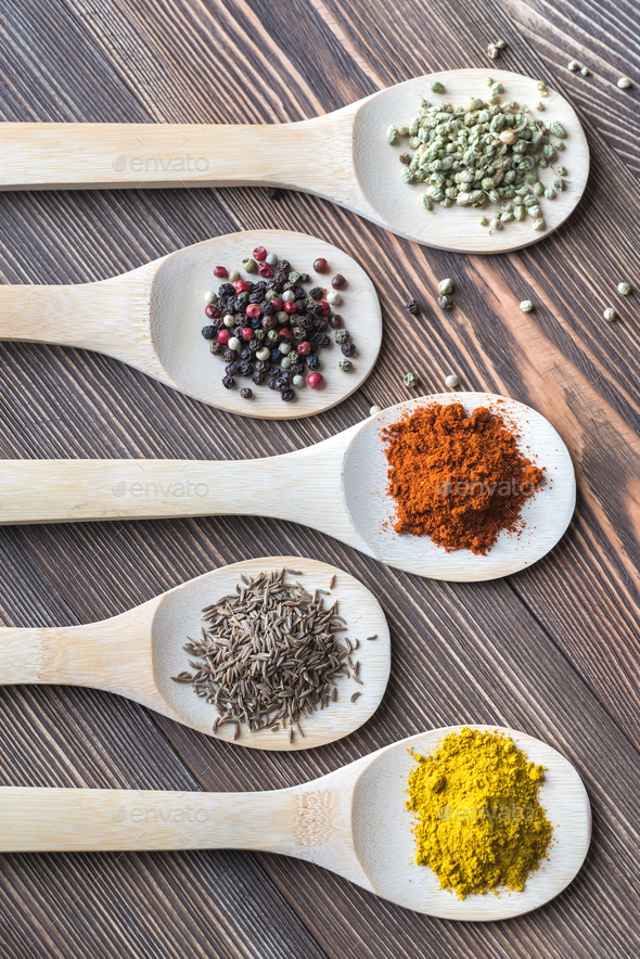 Assortment of spices on the wooden spoons - Stock Photo - Images