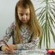 A Girl at the Desk Coloring the Notebook - VideoHive Item for Sale