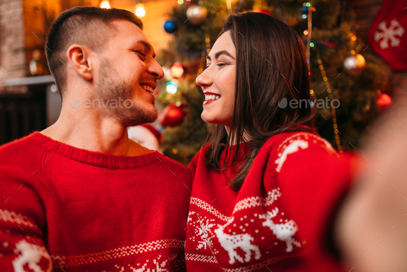 Love couple makes selfie, Christmas celebration - Stock Photo - Images