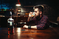 Man sitting at the bar and drink strong alcohol - PhotoDune Item for Sale