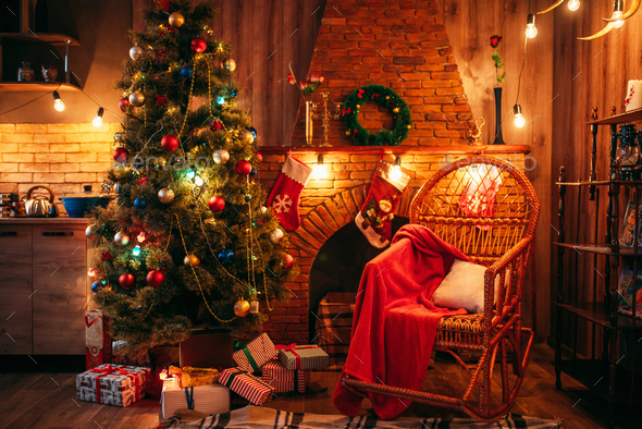 Christmas tree in the room with holiday decoration - Stock Photo - Images
