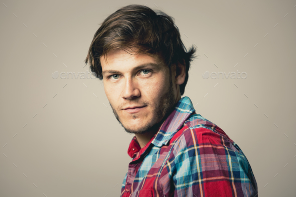 caucasian man wearing checkered shirt and trendy hairstyle - Stock Photo - Images