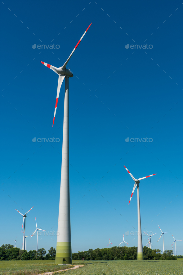 Windwheels in front of a blue sky  - Stock Photo - Images