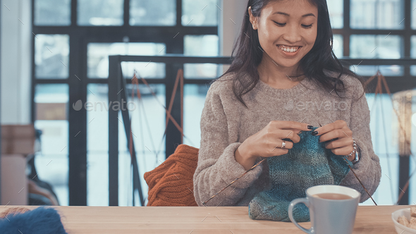 Smiling woman with a niddles - Stock Photo - Images