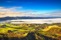 Balze of Volterra foggy morning panorama, farmlands and green fi - PhotoDune Item for Sale