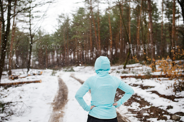 Senior woman jogging in winter nature. - Stock Photo - Images
