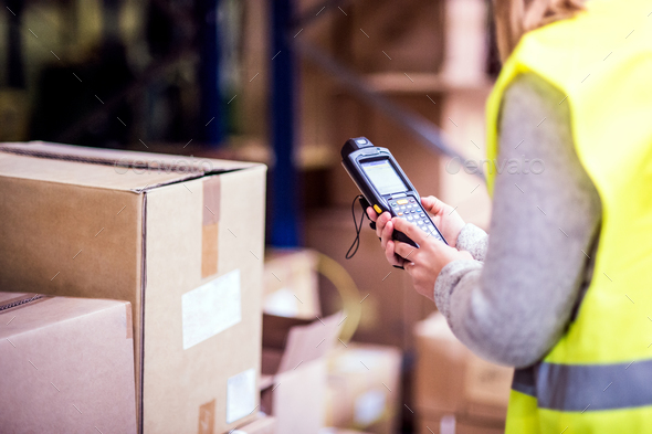 Warehouse woman worker with barcode scanner. - Stock Photo - Images
