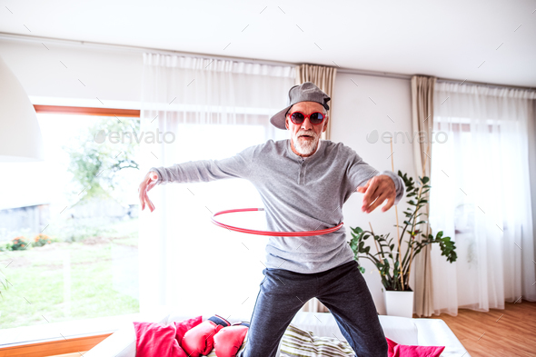 Senior man having fun at home. - Stock Photo - Images