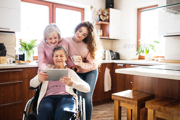A teenage girl with mother and grandmother at home. - Stock Photo - Images