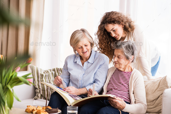 A teenage girl, mother and grandmother at home. - Stock Photo - Images