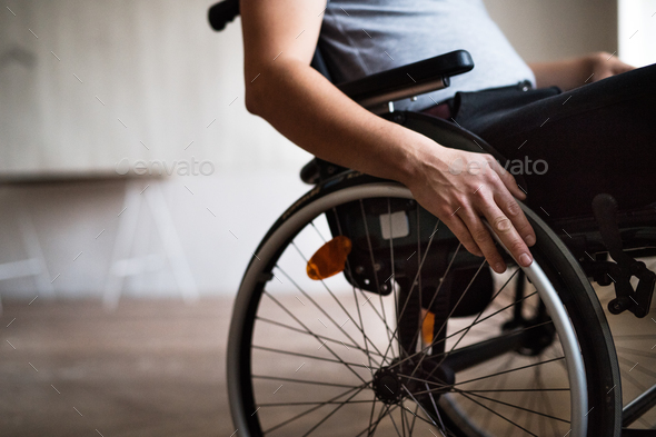 Man in wheelchair at home or in office. - Stock Photo - Images