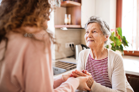 A teenage girl with grandmother at home. - Stock Photo - Images