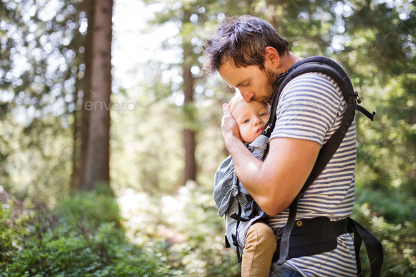 Young father with little boy in forest, summer day. - Stock Photo - Images