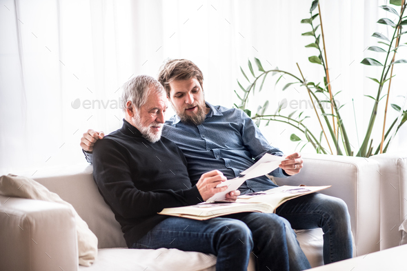 Hipster son and his senior father at home. - Stock Photo - Images