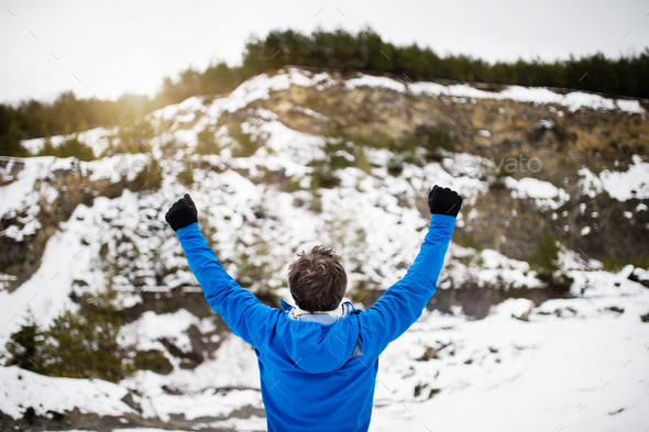Senior man jogging in winter nature. - Stock Photo - Images