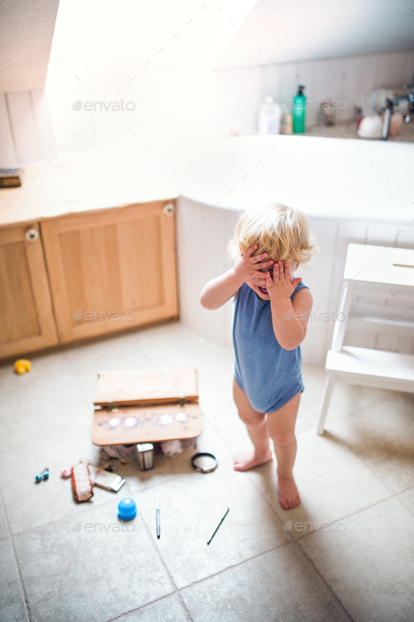Toddler boy in a dangerous situation in the bathroom. - Stock Photo - Images