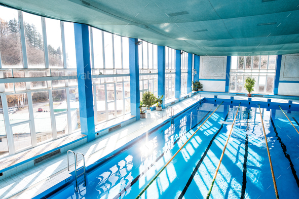 An interior of an indoor public swimming pool. - Stock Photo - Images