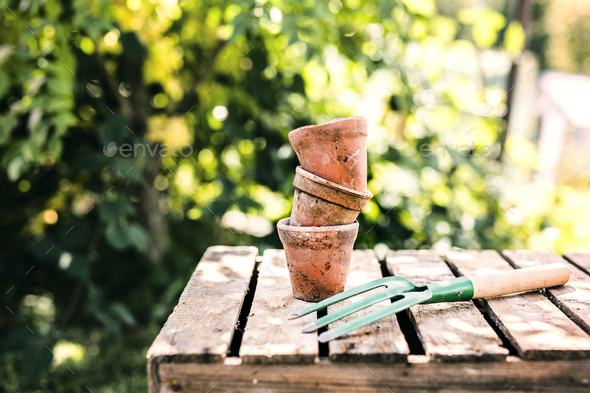 Garden tool and flower pots in the garden. - Stock Photo - Images