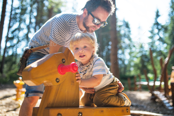 Father with little boy on the playground. - Stock Photo - Images