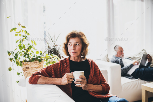 Senior couple relaxing at home. - Stock Photo - Images