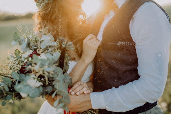 Beautiful bride and groom at sunset in green nature. - Stock Photo - Images