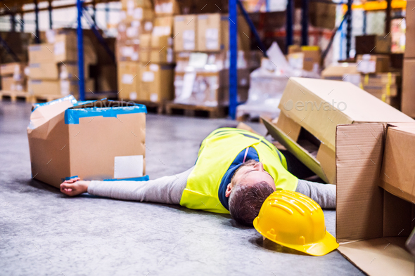 Warehouse worker after an accident in a warehouse. - Stock Photo - Images