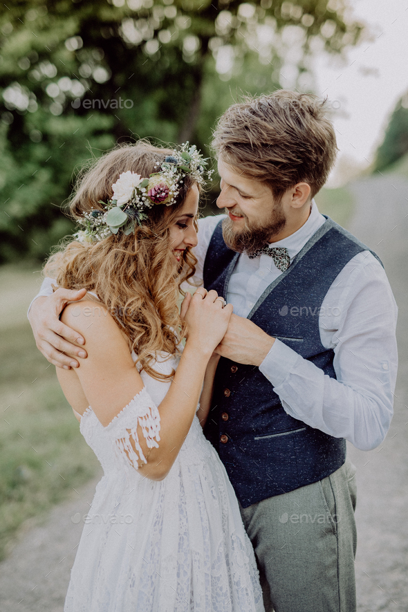Beautiful bride and groom in green nature. - Stock Photo - Images
