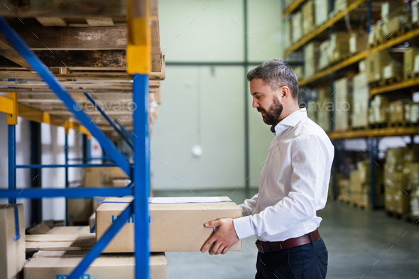 Male warehouse worker or supervisor. - Stock Photo - Images