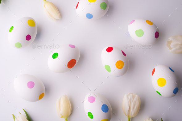 Flowers and dotty eggs on a white background. - Stock Photo - Images