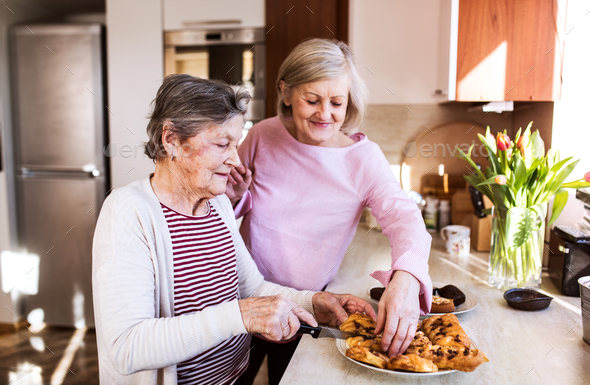 Senior women preparing food in the kitchen. - Stock Photo - Images