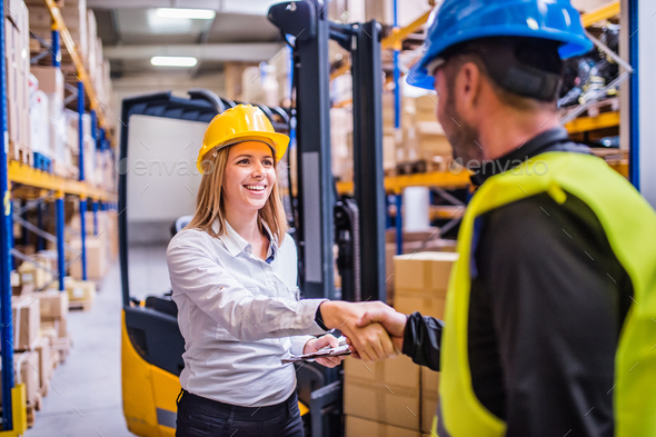 Young warehouse workers working together. - Stock Photo - Images