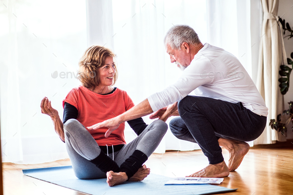 Senior couple doing exercise at home. - Stock Photo - Images
